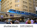 SYDNEY, AUSTRALIA - MARCH 22: A monorail runs above the public street in city center of Sydney on March 22,2012 in Sydney. The monorail is a unique public transport system in Sydneys CBD. - stock photo