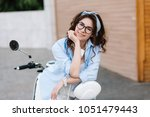 portrait of dreamy girl in... | Shutterstock . vector #1051479443