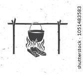 pot on the fire silhouette.... | Shutterstock .eps vector #1051483583