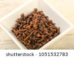 clove seeds in the bowl   cpice ... | Shutterstock . vector #1051532783