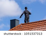 chimney sweep cleaning a... | Shutterstock . vector #1051537313