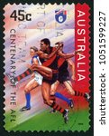 Small photo of AUSTRALIA - CIRCA 1996: post stamp printed in Australia shows Essendon Bombers; Australian football league; centenary of AFL; Scott 1505 45c; circa 1996