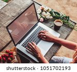 workspace with girl's hands ... | Shutterstock . vector #1051702193