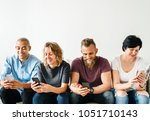 people using a smartphone | Shutterstock . vector #1051710143