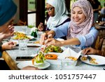 muslim women hijab having dinner | Shutterstock . vector #1051757447