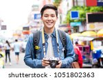 smiling young happy asian male...   Shutterstock . vector #1051802363