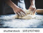 making dough by female hands at ...   Shutterstock . vector #1051937483