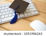 graducate cap on keyboard with... | Shutterstock . vector #1051986263