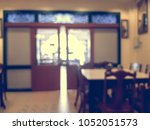 blur resturant and coffee shop... | Shutterstock . vector #1052051573
