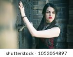 beautiful and sexy gothic girl...   Shutterstock . vector #1052054897
