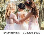 Bridesmaids Help Bride To Put...