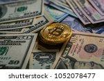 golden bitcoin on money bills... | Shutterstock . vector #1052078477