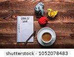 2018 goals on his notebook. new ... | Shutterstock . vector #1052078483