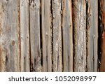 old weathered wooden fence... | Shutterstock . vector #1052098997