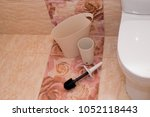 white counting bucket toilet... | Shutterstock . vector #1052118443