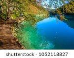 amazing view of wooden pathway... | Shutterstock . vector #1052118827