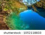 amazing view of wooden pathway... | Shutterstock . vector #1052118833