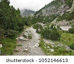 footpath through a valley in... | Shutterstock . vector #1052146613