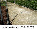 shadow of street lamp in sunny... | Shutterstock . vector #1052182577