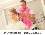 caring father. delighted... | Shutterstock . vector #1052233613