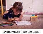 cute little girl painting...   Shutterstock . vector #1052258303