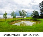 pond to the country house on a... | Shutterstock . vector #1052271923