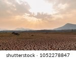 cracked dry land without water... | Shutterstock . vector #1052278847