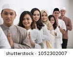 group of muslim asian men and... | Shutterstock . vector #1052302007