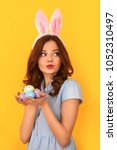 young woman studio isolated on...   Shutterstock . vector #1052310497