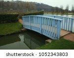 Small Wooden Blue Bridge Over...
