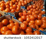 red tomatoes in carton boxes in ...   Shutterstock . vector #1052412017