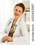 laughing medical doctor woman... | Shutterstock . vector #1052433587