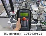 industry 4.0 concept. man is... | Shutterstock . vector #1052439623