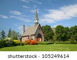 The Memorial Church of Grand Pre located in the Annapolis Valley of Nova Scotia in the Grand Pre National Historic Site, a park commemorating the deportation of the Acadians between 1755 and 1763. - stock photo