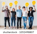 peopl with lightbulb icon | Shutterstock . vector #1052498807