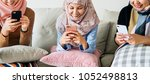 muslim hijab women using... | Shutterstock . vector #1052498813