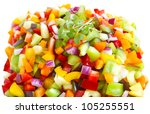 Young mustard green plant over colorful pepper and onion cut in cubes - stock photo