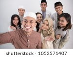 group of happy young muslim... | Shutterstock . vector #1052571407