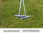 putters in grass | Shutterstock . vector #1052598203