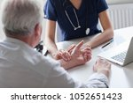 measuring of pulse on wrist by... | Shutterstock . vector #1052651423