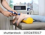 patient at shock wave therapy... | Shutterstock . vector #1052655017