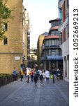 Small photo of View to the historic walkway through the Shad Thames with brick buildings in Bermondsey - London, Great Britain - 08/01/2015
