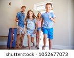 family arriving at summer... | Shutterstock . vector #1052677073