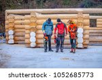 three men are having chain saws ...   Shutterstock . vector #1052685773