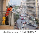 march 22  2018. a janitor looks ... | Shutterstock . vector #1052701277