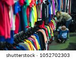 woman and child browsing...   Shutterstock . vector #1052702303