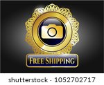 gold badge with photo camera...