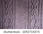 top view of puce knitted fabric ... | Shutterstock . vector #1052714273