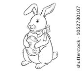 easter bunny with egg coloring... | Shutterstock .eps vector #1052730107