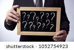 question marks written on...   Shutterstock . vector #1052754923